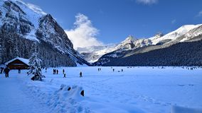 Lake Louise in winter a glacial lake frozen up covered with deep snow. Located in Banff NP Alberta Canada wide image stock photo