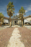 Palm tree walkway leads to house destroyed Royalty Free Stock Photos