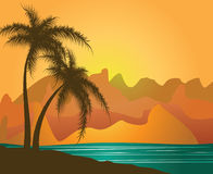 Palm trees against mountains and the sea Stock Photography