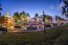 Palm trees and art deco hotels at Ocean Drive Stock Images