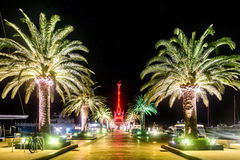 Palm trees and the buildings in the night lights in Marina Porto Stock Photos