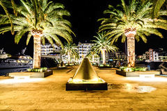 Palm trees and the buildings in the night lights in Marina Porto. Palm trees and the buildings and yachts in the night lights in Marina Porto Montenegro, Tivat Stock Photography