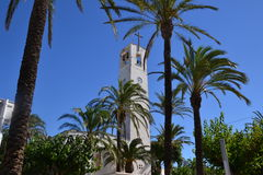 Palm trees and church in Ebro Delta in Spain Royalty Free Stock Photography