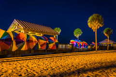 Palm trees and colorful beach umbrellas at night in Clearwater B. Each, Florida Stock Images
