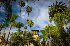 Palm trees and the exterior of the Mission Inn  Stock Images