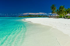 Palm trees over stunning lagoon and white sandy beach Stock Image