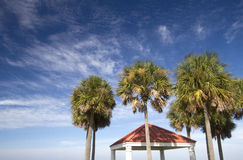 Palm trees and pavilion  under blue sky Royalty Free Stock Photography