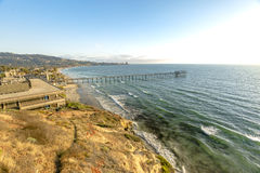 Palm trees and Pier on Scripps Beach at sunset in California Royalty Free Stock Photo