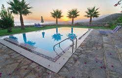 Palm Trees and Pool in an Aegean sunrise Stock Images
