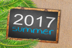 Palm trees and 2017 summer writen on blackboard Stock Image