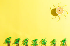 Palm trees and sun flat lay on yellow background Stock Photography