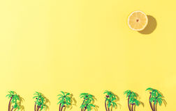 Palm trees and sun flat lay on yellow background Stock Image