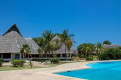 Palm trees tropical luxury hotel resort and swimming pool Royalty Free Stock Photo