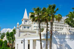 Palm trees and white building Stock Images