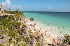 Tulum Beach in Tulum ruins, Mexico. Palm trees and white sandy beach with turquoise water in Tulum Beach in Tulum ruins, Mexico royalty free stock photo