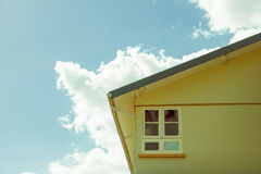 Palm trees in window. Section of a house against sky in the caribbean Stock Image