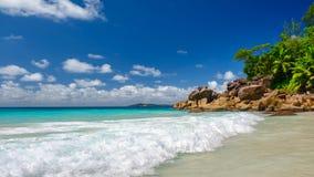 Palm and tropical beach panorama. Praslin island, Seychelles royalty free stock photo