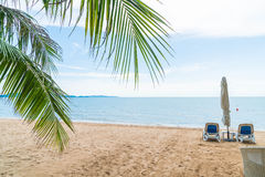 Palm and tropical beach at Pattaya in Thailand Stock Photo