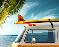 Palm Van. Detail of a vintage van in the beach with a surfboard on the roof Stock Photography
