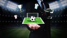 Palma abierta del hombre de negocios, alrededor del icono del fútbol, campo de fútbol, animación (alfa incluida) libre illustration