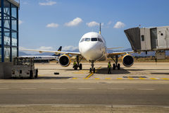 PALMA AIRPORT, MALLORCA - 1 AUGUST 2015. Airplane arrived at air. Close-up of large aircraft at after arriving at airport stand close to terminal building royalty free stock images