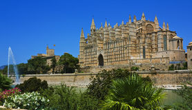 Palma Cathedral with fountain, Majorca. Panorama of Cathedral of Santa Maria of Palma (La Seu) with fountain, Majorca, Spain Stock Photo