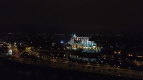 Palma Cathedral of Santa Maria at night in Palma Mallorca Spain. Aerial view landscape of the Majorca, Spain stock video footage