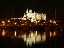 Palma de Mallorca. Gothic cathedral of La Seu, Palma de Mallorca, lit up at night. View from fishing harbour stock photography