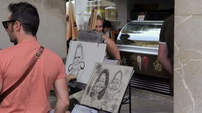 Palma de Mallorca, Artists on the street draw for tourists. stock video footage