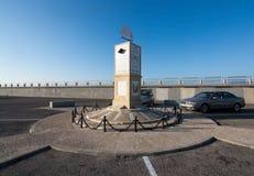 Seaside bicycling route. PALMA DE MALLORCA, BALEARIC ISLANDS, SPAIN - DECEMBER 22, 2015: Small Molinar lighthouse with winds decor seaside bicycling route along Stock Photography