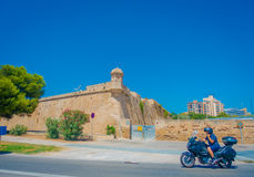 Free PALMA DE MALLORCA, SPAIN - AUGUST 18 2017: Motorbike Traveling Near Of Cathedral Of Santa Maria Of Palma La Seu In A Royalty Free Stock Images - 98882389