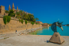 PALMA DE MALLORCA, SPAIN - AUGUST 18 2017: Beautiful view of Cathedral of Santa Maria of Palma La Seu in a gorgeous blue. Sky, with an artifical pond with a Stock Photography