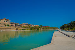 PALMA DE MALLORCA, SPAIN - AUGUST 18 2017: Beautiful view of Cathedral of Santa Maria of Palma La Seu in a gorgeous blue. Sky, with an artifical pond, in Palma Stock Image