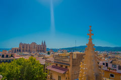 PALMA DE MALLORCA, SPAIN - AUGUST 18 2017: Gorgeous view of rooftops of the city of Palma de Mallorca with the Cathedral Stock Images