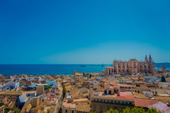 PALMA DE MALLORCA, SPAIN - AUGUST 18 2017: Gorgeous view of rooftops of the city of Palma de Mallorca with the Cathedral. Of Santa Maria in the horizont in a Stock Images