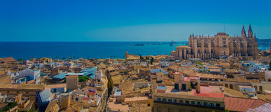 PALMA DE MALLORCA, SPAIN - AUGUST 18 2017: Gorgeous view of rooftops of the city of Palma de Mallorca with the Cathedral. Of Santa Maria in the horizont in a Royalty Free Stock Photography