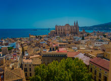 PALMA DE MALLORCA, SPAIN - AUGUST 18 2017: Gorgeous view of rooftops of the city of Palma de Mallorca with the Cathedral Royalty Free Stock Photos