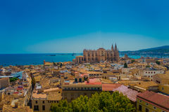PALMA DE MALLORCA, SPAIN - AUGUST 18 2017: Gorgeous view of rooftops of the city of Palma de Mallorca with the Cathedral Stock Image