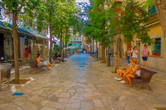 PALMA DE MALLORCA, SPAIN - AUGUST 18 2017: Unidentified people sitting in a public chairs while other turist keep Stock Images
