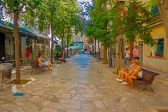 PALMA DE MALLORCA, SPAIN - AUGUST 18 2017: Unidentified people sitting in a public chairs while other turist keep Stock Photography
