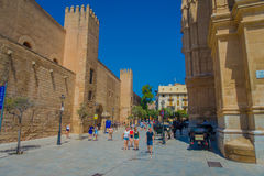 PALMA DE MALLORCA, SPAIN - AUGUST 18 2017: Unidentified people walking near of Cathedral of Santa Maria of Palma La Seu Stock Photography