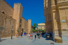 PALMA DE MALLORCA, SPAIN - AUGUST 18 2017: Unidentified people walking near of Cathedral of Santa Maria of Palma La Seu Stock Images