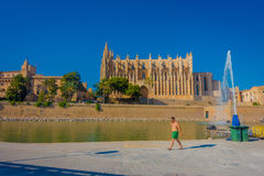 PALMA DE MALLORCA, SPAIN - AUGUST 18 2017: Unidentified people walking throught the city with a Cathedral of Santa Maria Royalty Free Stock Images