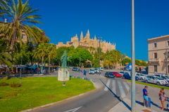 PALMA DE MALLORCA, SPAIN - AUGUST 18 2017: Unidentified people walking throught the city with a Cathedral of Santa Maria Royalty Free Stock Photography