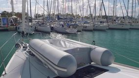 PALMA DE MALLORCA, SPAIN - CIRCA NOVEMBER 2017: Side view of rigid inflatable boat on yacht board. View of rigid inflatable boat on yacht board in marina stock video footage