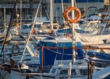 Portixol marina moored boats. PALMA DE MALLORCA, SPAIN - JANUARY 4, 2018: Portixol marina moored boats in afternoon sunshine on January 4, 2018 in Palma de Stock Images