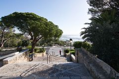 Bellver castle morning view. PALMA DE MALLORCA, SPAIN - March 10, 2017: City view and stairs with pedestrian crossing from Bellver castle on March 10, 2017 in Stock Image