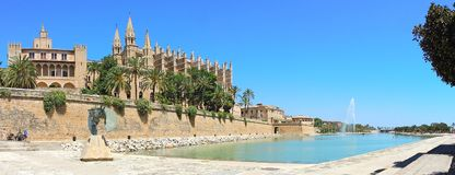 Palma de Mallorca, Spain. The Royal Palace of La Almudaina and the gothic Cathedral of Santa Maria. Summer time Royalty Free Stock Photography