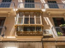 Palma de Mallorca, Spain. The typical balconies on the facades of the buildings and houses in the old city center. Summer time Royalty Free Stock Photo