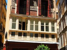 Palma de Mallorca, Spain. The typical balconies on the facades of the buildings and houses in the old city center. Summer time Stock Photography